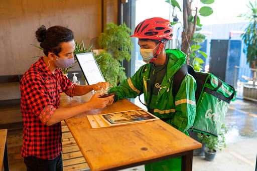 Image-3_-A-GrabFood-delivery-partner-collects-an-order-at-Cafe-Salween_Credit-to-Grab-Myanmar