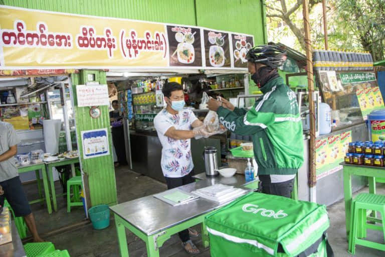 Image-6_-A-GrabFood-delivery-partner-picking-up-an-order-at-Tin-Tin-Aya-in-Yangon_Credit-to-Grab-Myanmar